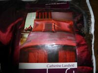 Red bedspread set in handy carry bag