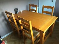 Large wooden dinning table with chairs