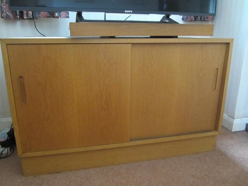 Wooden Tv Cabinet With Turntable For And Pull Out Shelves Sliding Doors