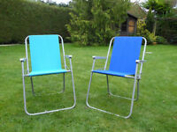 Two lightweight folding garden chairs.