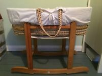 Moses basket and rocking stand, barely used. Smoke free pet free home.