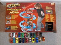 Toy garage with 24 cars, boxed, excellent condition, £15