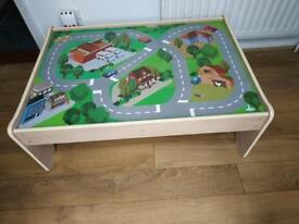 Wooden train table with train set