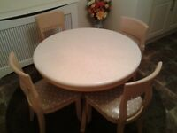REDUCED Round table with marble look top and six chairs with rug and three tablecloths included