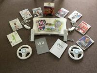 Wii deluxe family pack plus Wii fit and various games some unopened plus various controllers