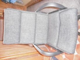 Office chair brown padded fabric.