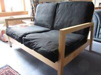 Ikea Sofa light wood with black cushions