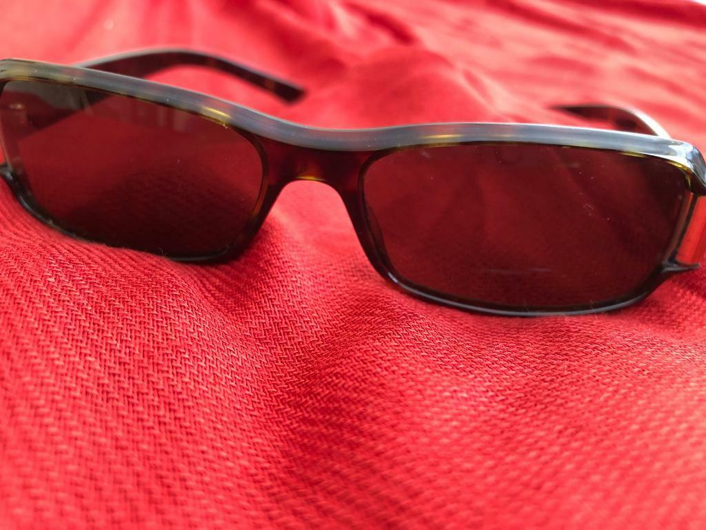 4a3c87bc414 Gucci rectangle sunglasses with tortoise shell arms