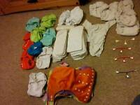 A large bundle of re-usable Nappies (All sizes)