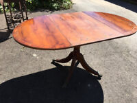Oval drop leaf claw foot dining table