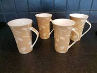 Four Tall mugs excellent condition