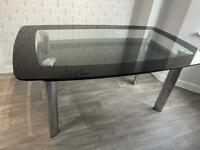 Harvey's boat black and clear glass dining room table