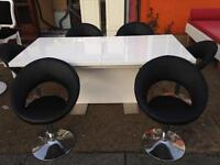 White high gloss extendable table and 6 chairs