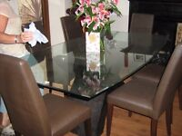 glas top table and 6 high back chairs