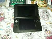 nintendo 3ds xl with games card