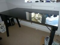 Black glass desk with professional black office chair