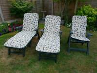 Set of 2 garden reclining loungers and 1 chair with padded cushions
