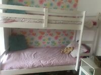 White wooden bunk beds with mattress