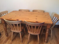 Strong solid pine farmhouse dining table,5ft with 6 chairs, in need of tlc, ideal for a project