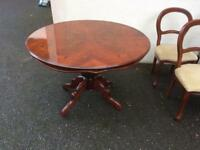 Beautiful patterned wooden table with 4 chairs