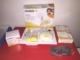 Medela Swing breast bump with new diaphragm fitted and extra bags