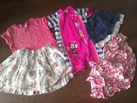 Girls clothes bundle age 12-18 months. Includes: A sweet Flowery skirt from Next +swimsuit + tshirt