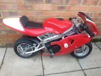 Red mini moto 2 stroke