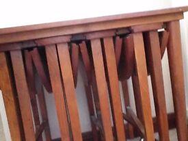 Nest of oak tables.