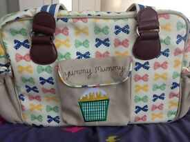 Pink Lining Yummy Mummy changing bag with rare bow print
