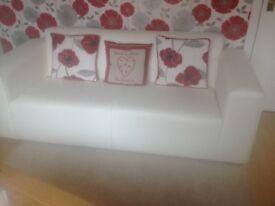 3 seater cream leather sofa.