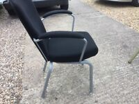 Black hotel quality stacking chairs with arms