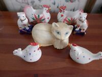 A collection of cat and chicken ornaments