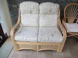 Almost new cane settee & two armchairs