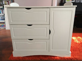 White chest of drawers and cupboard