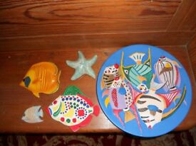 A lovely collection of colourful ceramic wall hanging fish