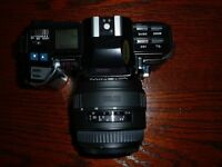 A Minolta 7000 AF SLR Film Camera with Sigma Zoom Lens and Flash Unit