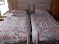 2 Single Pink Beds. Very good condition. Teenage girls moving onto double beds.