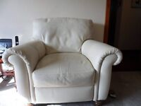 2 buttery cream leather armchairs with wooden bun legs