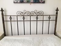 Antique gold wrought iron head board, 4ft 6in wide