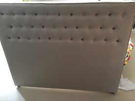 Double bed head board. Made by Loaf. Beige linen with blue buttons. Immaculate.