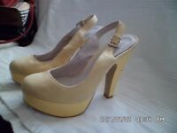 ladies size 5 suede platform heels by FAITH