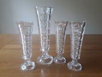Set of four glass vases