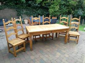 Large solid timber dining table and chairs