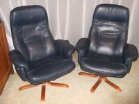 Tilting, swivelling dark blue leather chairs