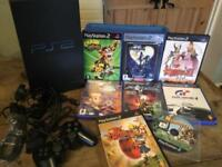 Sony PlayStation 2 with all leads, and controller nice condition, with 8 games ,