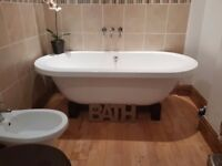 Bathtub, freestanding on wooden blocks.Taps included. A lovely modern feature bath .