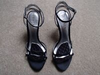 Brand new, boxed and never worn Ralph Lauren black high heel shoes. Size 5 UK