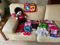 Build a bear with several outfits and travel bag.