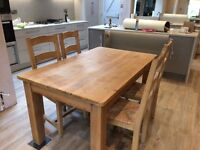 Solid Pine table and six chairs. 145 x 90 cms. Excellent condition