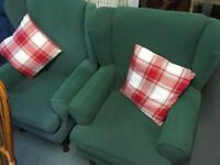 TWO OLIVE GREEN FABRIC WINGBACK ARMCHAIRS